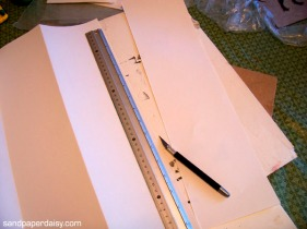 To cut the paper all I used was a metal ruler and a cheap mat knife. I also have an old Xacto knife I use for that stuff.