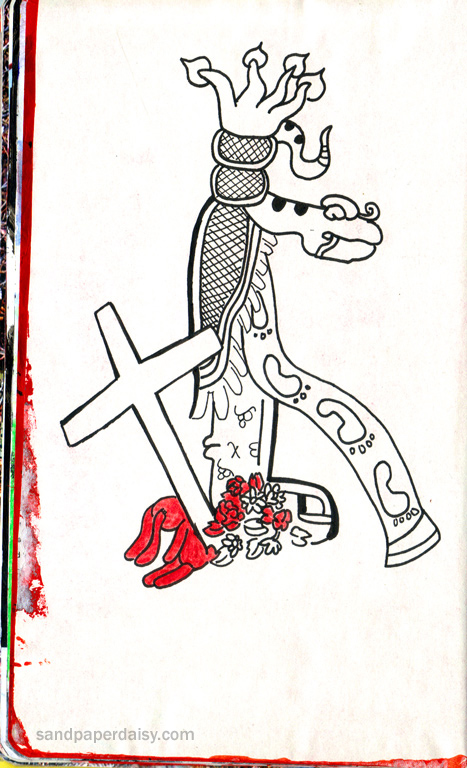 a maya totem depicting a road shown as a ribbon with footprints on it along with a road cross and stuffed bunny erected as a tribute to a fatal road accident