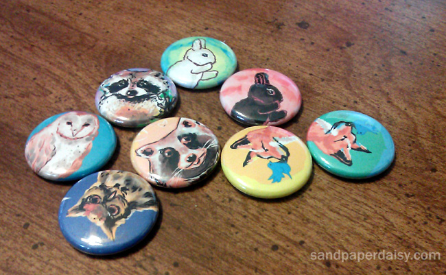 1 inch pinback buttons for art in the wild featuring adorable animals like owls raccoons foxes and rabbits