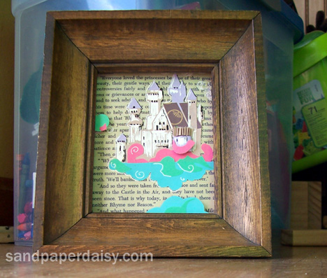 a picture with a fairy castle in the clouds made out of paper collaged onto an old page from The Phantom Tollbooth