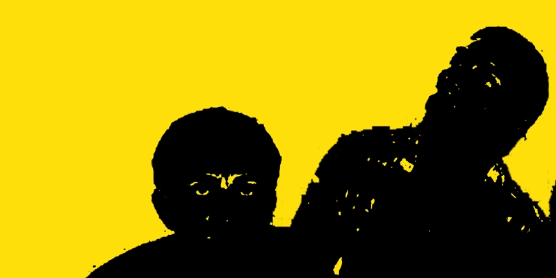 two shadowy faceless men, one staring at the viewer