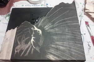 """Covering """"Agnes/Adam"""" in an old proof of my """"Wild Birds"""" lino plate"""