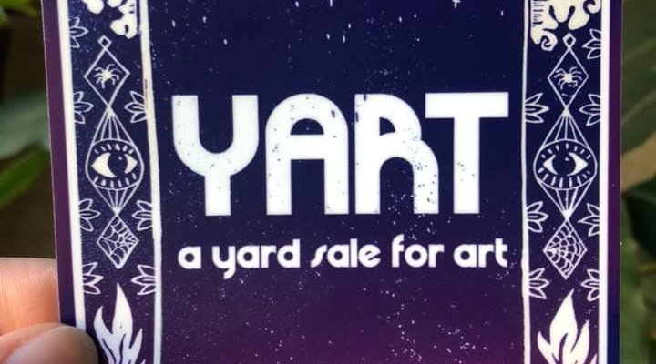 A 3 inch vinyly sticker for YART, a yardsale for art, a show in Evansville IN. The sticker is a beautiful deep blue to purple gradient featuring white text and flame and star designs flanking the YART logo and information.