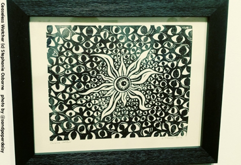 A black and white lino cut showing many hundreds of staring writhing human eyes by artist Stephanie Osborne