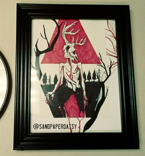 Framed Ink and red copic drawing of a wendigo, a native american legend of a crazed human or creature that feasts on human flesh. Resembles an emaciated man wearing or having the head of a deer skull.